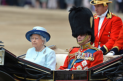Image ©Licensed to i-Images Picture Agency. 14/06/2014. <br /> <br /> Pictured is The Queen with The Duke of Edinburgh in a horse drawn carriage during the parade at the Trooping of the Colour.<br /> <br /> Trooping The Colour, Her Majesty The Queens Birthday Parade at Horse Guards Parade, London, UK.<br /> <br /> Saturday 14th of June 2014.<br /> Picture by Ben Stevens / i-Images