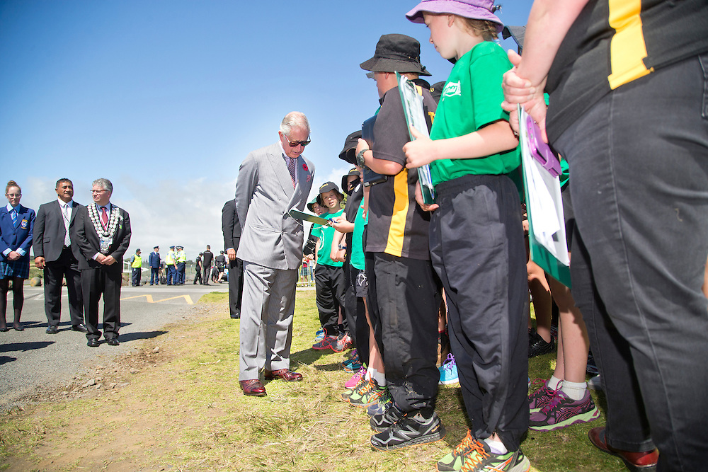 Prince Charles, Prince of Wales meets with school kids after crossing the Te Rewa Rewa Bridge and walking the Coastal Walkway, New Plymouth, New Zealand, New Zealand, Monday, November 09, 2015. Credit:SNPA / Fairfax, Charlotte Curd  **POOL**