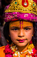 Young girl dressed as Radha (Hindu Goddess and lover and companion of Hindu God Krishna);  Chhadi Mar Holi (local Holi celebration), Holi Festival (Festival of Colors), village of Gokul, near Mathura, Uttar Pradesh, India.