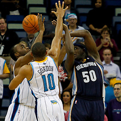 December 21, 2011; New Orleans, LA, USA; New Orleans Hornets shooting guard Eric Gordon (10) and power forward Carl Landry (24) defend against Memphis Grizzlies power forward Zach Randolph (50) during the second half of a preseason game at the New Orleans Arena. The Hornets defeated the Grizzlies 95-80.  Mandatory Credit: Derick E. Hingle-US PRESSWIRE