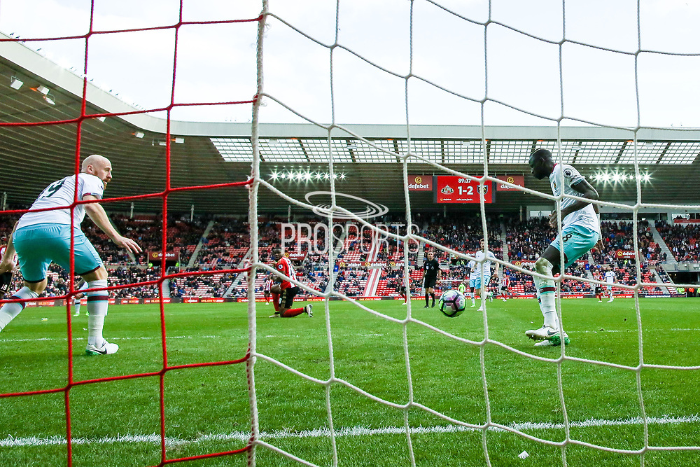 West Ham United Defender James Collins (19) and West Ham United Midfielder Cheikhou Kouyate (8) are helpless as Sunderland forward Fabio Borini (9) shot goes in to level the scores at 2-2 during the Premier League match between Sunderland and West Ham United at the Stadium Of Light, Sunderland, England on 15 April 2017. Photo by Simon Davies.