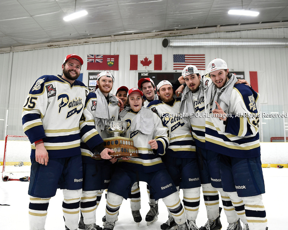 TORONTO, ON - Apr 22, 2015 : Ontario Junior Hockey League game action between the Toronto Patriots and the Kingston Voyaguers. Game seven of the Buckland Cup Championship Series. Toronto Patriots teammates celebrate with the Buckland Cup.<br /> (Photo by Andy Corneau / OJHL Images)