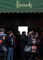 © Licensed to London News Pictures. 27/12/2011. LONDON, UK. Hundreds of shoppers queue for bargains at London's most famous departments store as they wait for the beginning of the 2011 Harrods Christmas Sale in London today (27/12/11). Photo credit: Matt Cetti-Roberts/LNP