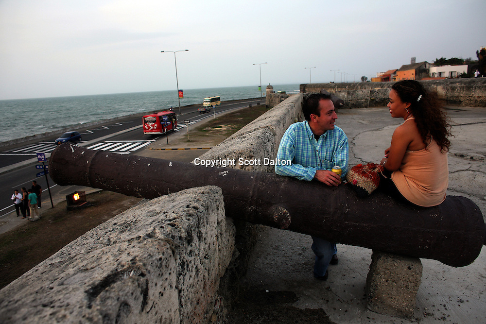 A couple talks on the wall that surrounds Cartagena?s old city, on Saturday, April 19, 2008. (Photo/Scott Dalton).