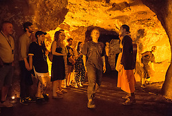 &copy; Licensed to London News Pictures.  21/07/2018; Bristol, UK. Bristol Harbour Festival. Performance in Redcliffe Caves of Beneath Our Feet, performed by Made by Katie Green dance company. Performer Katie Green gathers together willing audiences for an extraordinary expedition into one of Bristol's hidden and normally closed spaces.<br /> Created in collaboration with archaeologists, geologists, historians, cavers and former miners, Beneath Our Feet is a promenade performance using dance and live music to tell the story of the underground. Bristol Harbour Festival is a 3 day extravaganza of dance, music, theatre, circus, ships and boats, arts and delicious food. The festival is free for all and brings over 250,000 people together each summer to celebrate Bristol's rich maritime history and enjoy some of the city&rsquo;s best music and entertainment. The festival takes place on the  20 - 22 July 2018. Photo credit: Simon Chapman/LNP