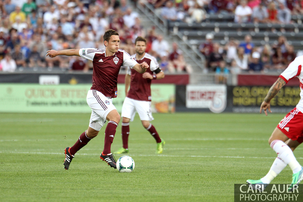 July 4th, 2013 - Colorado Rapids midfielder Shane O'Neill (27) dribbles the ball up the pitch in first half action of the Major League Soccer match between New York Red Bulls and the Colorado Rapids at Dick's Sporting Goods Park in Commerce City, CO