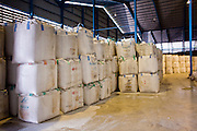 08 MAY 2010 - PATHUM THANI, THAILAND: Rice stored at the J&D Rice Group Ltd warehouse in Pathum Thani, about 30 miles north of Bangkok, Thailand. According to the UN Food and Agricultural Organization (FAO),Thailand's rice harvest is expected to be reduced by about 16% this year because of a persistent drought across the country but most pronounced in the northeast region of Thailand. A spokesperson for J&D said they get rice from across Thailand and so far there haven't been any shortages. J&D exports all of their rice China.  PHOTO BY JACK KURTZ