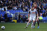 Tranmere Rovers' Steven Jennings passes the ball back under pressure from Carlisle United&rsquo;s Brad Potts. Skybet football league 1 match, Tranmere Rovers v Carlisle United at Prenton Park in Birkenhead, England on Saturday 29th March 2014.<br /> pic by Chris Stading, Andrew Orchard sports photography.