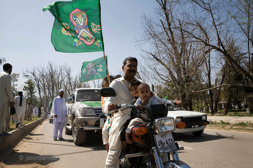 Eid-Milad-un-Nabi: Celebration of the Prophet's birthday in Islamabad Pakistan...A peaceful procession of followers rally toward the Al Raza Mosque in Islamabad to celebrate Eid-Milad-un-Nabi...People decorate mosques, their houses, cars and streets with colourful lightings and flags to express their love and reverence for Holy Prophet Hazrat Muhammad..