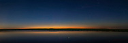 A 120&deg; panorama of the summer solstice twilight (at 12:30 am local time) looking north over the prairie pond near home in southern Alberta, taken June 19/20, 2018. <br /> <br /> Some very faint noctilucent clouds are at left but fading, while some very faint rays of auroral curtains are also visible in the photo but were invisible to the eye. The bright star Capella is at centre and reflected in the calm waters. Perseus is at right of centre. <br /> <br /> The red lights at right are from the wind turbines at the Wintering Hills Wind Farm. <br /> <br /> This is a stitch of 6 segments, with the 35mm lens at f/2.5 for 20 seconds each with the Canon 6DMkII at ISO 400. Stitching was with PTGui as ACR and Photoshop refused to merge these images with so much blank sky and water. <br /> <br /> Remarkably, there were no mosquitoes! But there were lots of sounds of birds and an encounter with something running down the road where I stood!