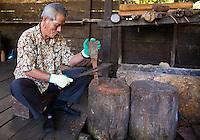 Kenyah man making a wooden spoon at the Sarawak Cultural Village near Kuching.
