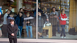 LIVERPOOL, ENGLAND - Thursday, April 10, 2014: Fans look on from the window of John Lewis at the launch of the new Warrior home kit for 2014/2015 at the Liverpool One shopping centre. (Pic by David Rawcliffe/Propaganda)