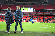 Ballboys watch the Tottenham Hotspur players warm-up ahead of the The FA Cup 4th round replay match between Tottenham Hotspur and Newport County at Wembley Stadium, London, England on 7 February 2018. Picture by Stephen Wright.
