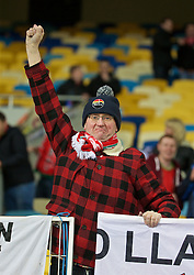 KIEV, UKRAINE - Easter Monday, March 28, 2016: A Wales supporter before the International Friendly match against Ukraine at the NSK Olimpiyskyi Stadium. (Pic by David Rawcliffe/Propaganda)