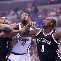 16 November 2013: Los Angeles Clippers center DeAndre Jordan (6) vies for the rebound with Brooklyn Nets shooting guard Alan Anderson (6) and Brooklyn Nets center Andray Blatche (0) during the Los Angeles Clippers 110-103 victory over the Brooklyn Nets at the Staples Center, Los Angeles, California, USA.