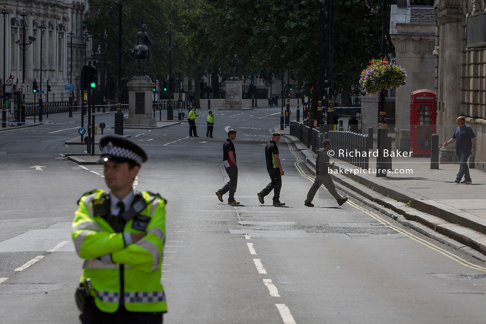 Police block Whitehall as Westminster experiences a lockdown with extensive cordons and the closure of many streets after what police are calling a terrorist incident in which a car was crashed into security barriers outside parliament in central London, on 14th August 2018, in London, England.
