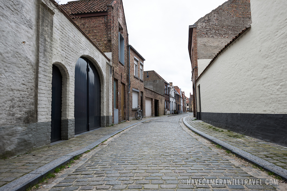 Cobblestone street in a residential section of historic Bruges.