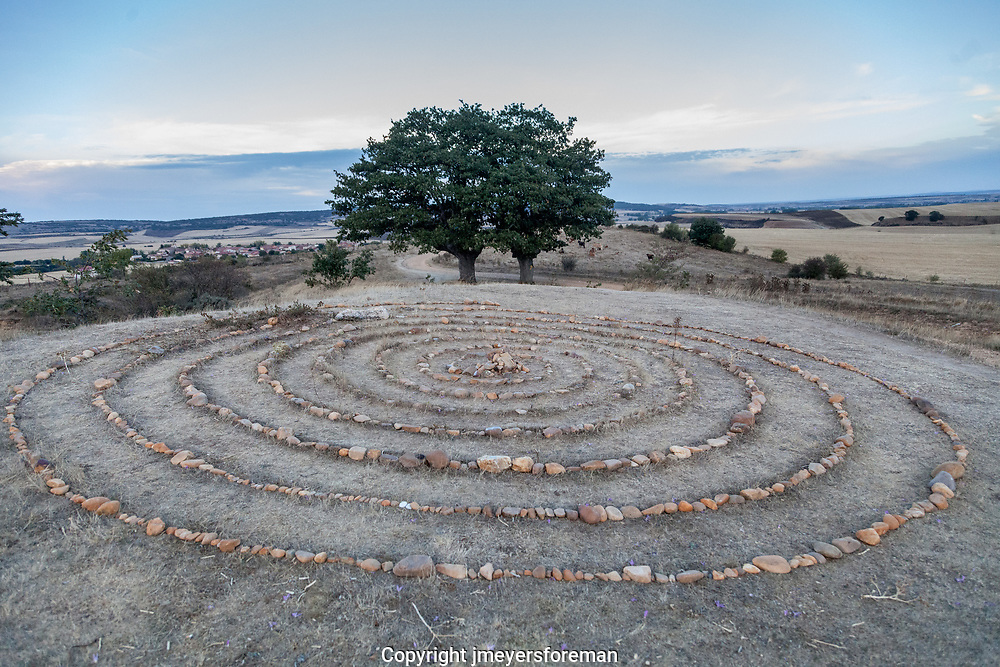 As we walk along the Camino to Santiago de Compostela from San Juan de Ortega to Burgos we found this stone labyrinth.