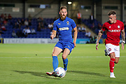 AFC Wimbledon midfielder Scott Wagstaff (7) passing the ball during the Pre-Season Friendly match between AFC Wimbledon and Bristol City at the Cherry Red Records Stadium, Kingston, England on 9 July 2019.