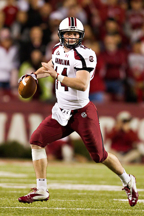FAYETTEVILLE, AR - NOVEMBER 5:   Quarterback Connor Shaw #14 of the South Carolina Gamecocks rolls out looking for a receiver against the Arkansas Razorbacks at Donald W. Reynolds Stadium on November 5, 2011in Fayetteville, Arkansas.  The Razorbacks defeated the Gamecocks 44 to 28.  (Photo by Wesley Hitt/Getty Images) *** Local Caption *** Connor Shaw