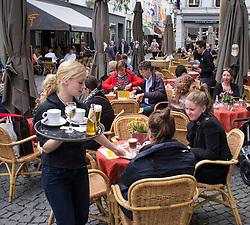 Busy cafes in pretty square in Maastricht Netherlands