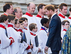 © Licensed to London News Pictures. 14/03/2016. London, UK. PRINCE HARRY talks to choir boys as he leaves Westminster Abbey in London after attending a service to mark Commonwealth Day 2016.  Photo credit: Ben Cawthra/LNP