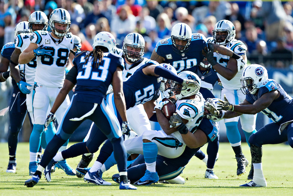NASHVILLE, TN - NOVEMBER 15:  Jonathan Stewart #28 of the Carolina Panthers is tackled by Wesley Woodyard #59 of the Tennessee Titans at Nissan Stadium on November 15, 2015 in Nashville, Tennessee.  (Photo by Wesley Hitt/Getty Images) *** Local Caption *** Jonathan Stewart; Wesley Woodyard