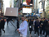 MACBOOK selfie sticks to snap pictures on the go