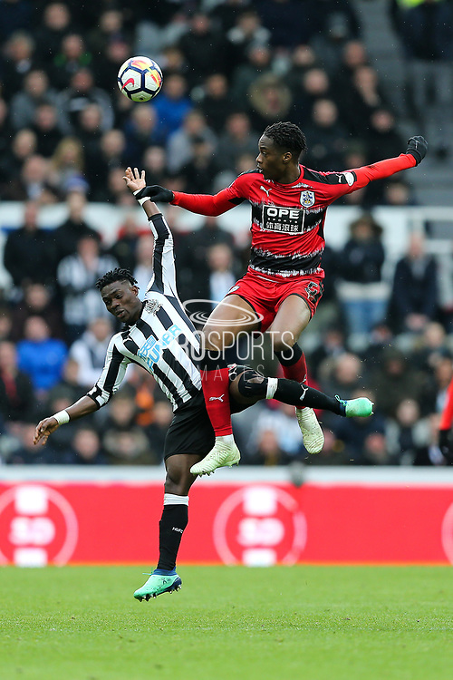 Terence Kongolo (#5) of Huddersfield Town wins a header against Christian Atsu (#30) of Newcastle United during the Premier League match between Newcastle United and Huddersfield Town at St. James's Park, Newcastle, England on 31 March 2018. Picture by Craig Doyle.