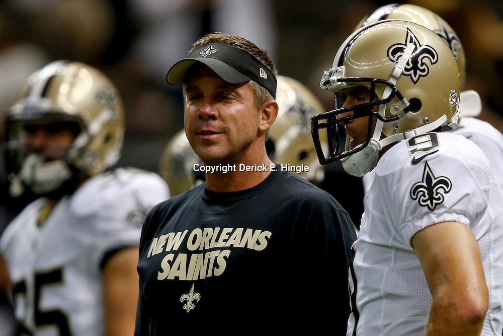 Aug 9, 2013; New Orleans, LA, USA; New Orleans Saints head coach Sean Payton and quarterback Drew Brees (9) during a preseason game at the Mercedes-Benz Superdome. The Saints defeated the Chiefs 17-13. Mandatory Credit: Derick E. Hingle-USA TODAY Sports
