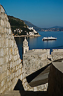 View of crusie ship in the Adriatic Sea docked at historic Dubrovnik, Croatia, a UNESCO World Heritage Site.