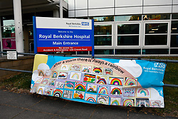 """After a storm there is always a rainbow"" message of hope banner during Coronavirus lockdown, Royal Berkshire Hospital UK May 2020"