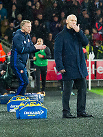 Football - 2016 / 2017 Premier League - Swansea City vs. Stoke City<br /> <br /> Swansea City manager Bob Bradley with hand on chin after swansea score their 1st goal, Sunderland Manager David Moyes encourages his side in background—, at The Liberty Stadium.<br /> <br /> COLORSPORT/WINSTON BYNORTH