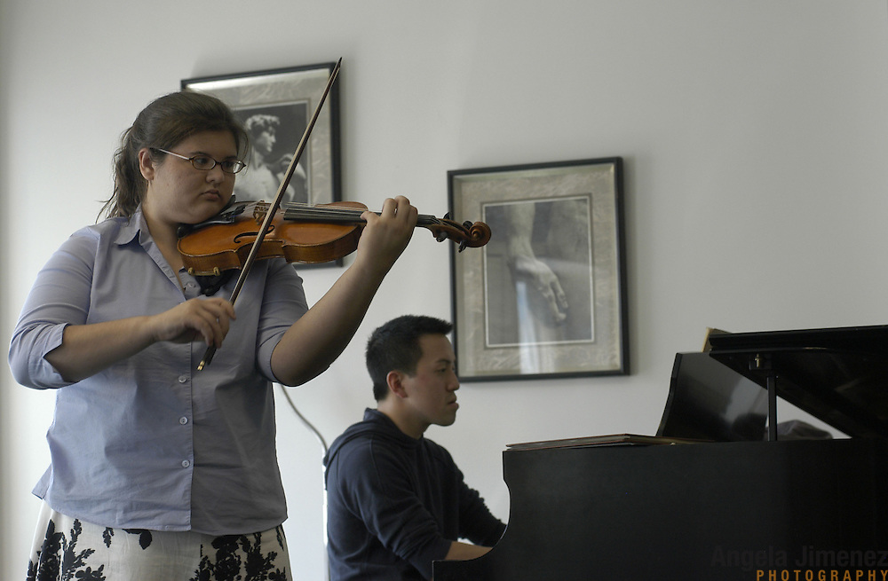"Violinist Elizabeth ""Libby"" Fayette of Long Island, New York, 17, left, accompanied by Paul Kwak on the piano, plays during her weekly private lesson in the Pre-College Division program at The Juilliard School, located at West 65th Street and Broadway in New York City, on Saturday, September 24, 2005. Students audition for spots in the prestigious program, in which they can study until they graduate from high school."