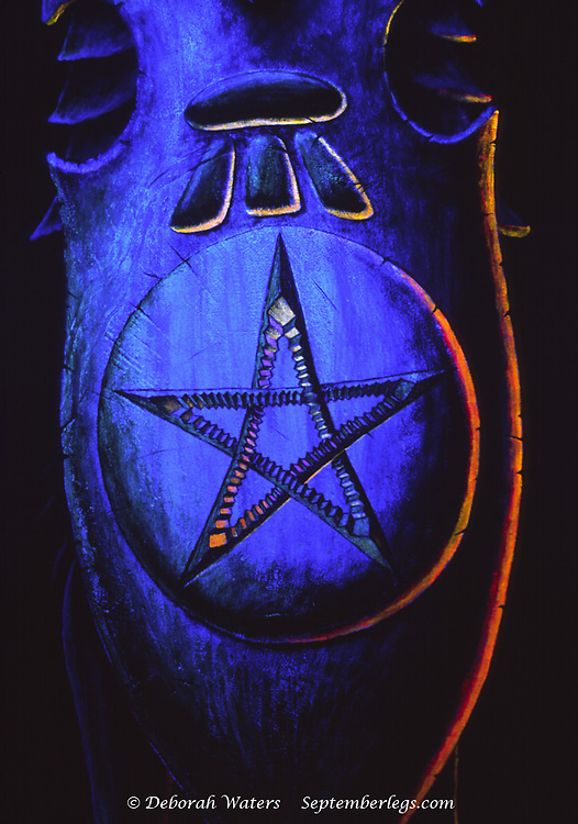 The Shield of Sir Real an ulta violet UV knight painting, decorated with pentacle star and tripod magical symbols. UK 2004