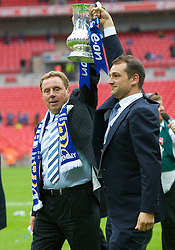 LONDON, ENGLAND - Saturday, May 17, 2008: Portsmouth's owner Alexandre Gaydamak celebrates with manager Harry Redknapp and the trophy after their side beat Cardiff City 1-0 during the FA Cup Final at Wembley Stadium. (Photo by David Rawcliffe/Propaganda)