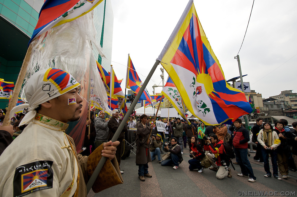 A man dressed in traditional Tibetan clothes prepares for a march in Taipei, Taiwan.