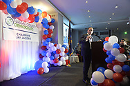 Garden City, New York, USA. November 6, 2018. Nassau County Democrats watch Election Day results at Garden City Hotel, Long Island. JAY JACOBS, Chairman of Nassau County Democratic Committee, is at podium, introducing Andrea Stewart-Cousins, who represents District 35 in the New York State Senate and serves as Senate Democratic Leader.