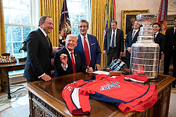 March 25, 2019 - Washington, District of Columbia, U.S. - President DONALD TRUMP meets with players from the 2018 Stanley Cup Champion Washington Capitals Monday, March 25, 2019, in the Oval Office of the White House (Credit Image: © White House/ZUMA Wire/ZUMAPRESS.com)