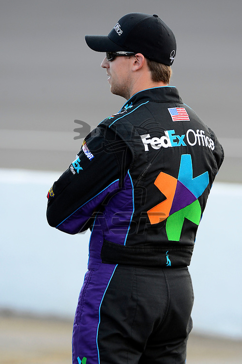 Brooklyn, MI  - Aug 17, 2012: Denny Hamlin (11) stands on pit row during qualifying for the Pure Michigan 400 at Michigan International Speedway in Brooklyn, MI.
