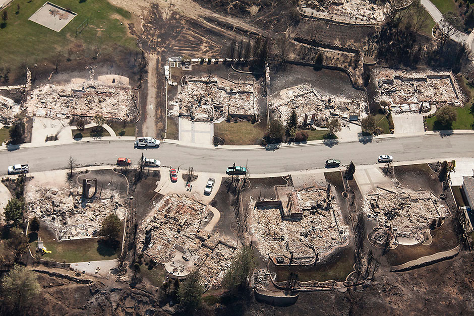Homes destroyed by the Sleepy Hollow fire are pictured in Wenatchee, Washington June 29, 2015.  Emergency officials ordered hundreds of people to leave their homes in central Washington state as a fast-moving wildfire destroyed at least nine properties and threatened businesses on Sunday. Many took refuge in shelters as the blaze ripped across 1,700 acres near the cities of Cashmere and Wenatchee in Chelan County, about 120 miles (200km) east of Seattle.  REUTERS/David Ryder