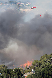 Residents have been evacuated as homes were threatened by a scrub fire in Burnside, Dunedin, New Zealand, Wednesday, January 31, 2018. Credit:SNPA / Adam Binns ** NO ARCHIVING**