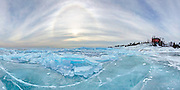 Marquette Lighthouse, sun halo and blue ice on Lake Superior