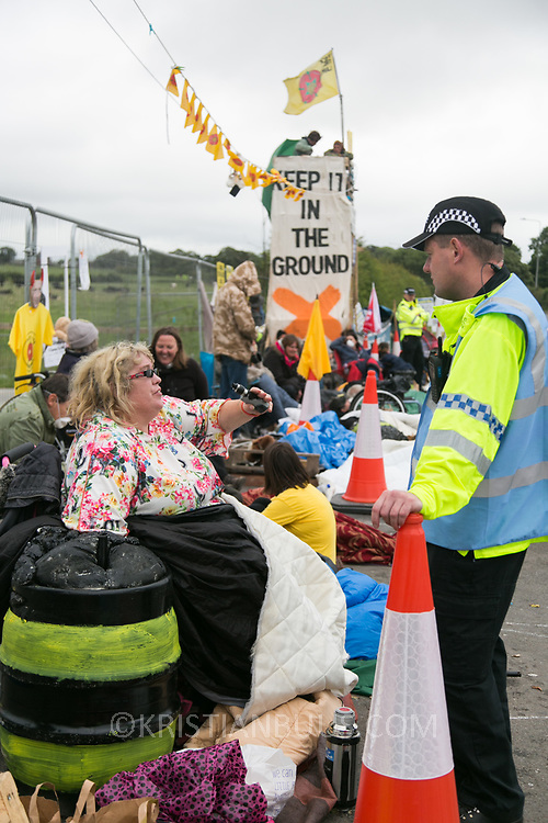 13 local activists locked themselves in specially made arm tubes to block the entrance to Quadrilla's drill site in New Preston Road, July 03 2017, Lancashire, United Kingdom. Pete Marquis chatting to the site manager at the Quadrilla drill site. Quadrilla's drill site after having cleared the wooden structures erected by activists outside Quadrilla's perimeter. The 13 activists included 3 councillors; Julie Brickles, Miranda Cox and Gina Dowding and Nick Danby, Martin Porter, Jeanette Porter,  Michelle Martin, Louise Robinson,<br /> Alana McCullough, Nick Sheldrick, Cath Robinson, Barbara Cookson, Dan Huxley-Blyth. The blockade is a repsonse to the emmidiate drilling for shale gas, fracking, by the fracking company Quadrilla. Lancashire voted against permitting fracking but was over ruled by the conservative central Government. All the activists have been active in the struggle against fracking for years but this is their first direct action of peacefull protesting. Fracking is a highly contested way of extracting gas, it is risky to extract and damaging to the environment and is banned in parts of Europe . Lancashire has in the past experienced earth quakes blamed on fracking.