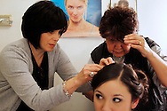 Anabel Navarro (left) and hairstylist Grace Cantu pin up Premont senior Mariela Navarro's hair Feb. 1, 2013 at Bertha's Beauty Salon in Premont, Texas. Cantu was getting the senior read for winter homecoming, and said she has been doing hair for Mariela, her mother and grandmother for years at the salon.