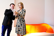 BRUSSEL - Queen Mathilde of Belgium with designer Charles Kaisin, visits the exhibition 'The Power of Objects - Design Bestsellers in Belgium ' on contemporary Belgian designers at the ING art center in Brussels, Belgium, 16 October 2014.  COPYRIGHT ROBIN UTRECHT