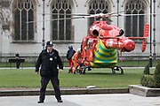 UNITED KINGDOM, London: 22 March 2017 An ambulance helicopter lands on Parliament Square after a suspected terror incident outside the Houses of Parliament in Westminster, London earlier today. It is reported that there has been at least one fatality. Rick Findler / Story Picture Agency