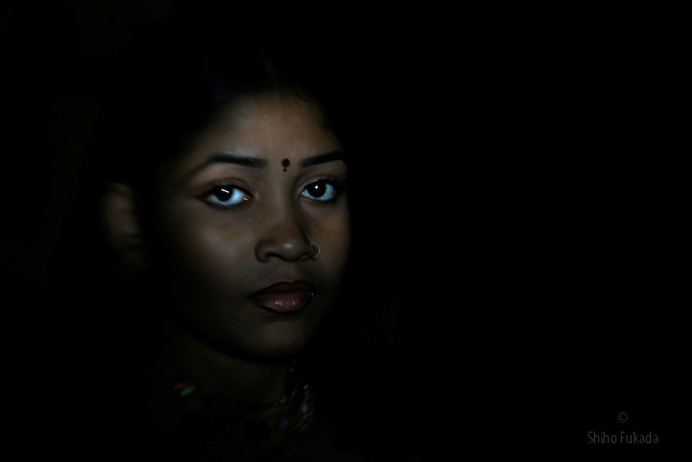 Sex worker Toma, 14, is seen at brothel, July 4, 2007 in Faridpur, Bangladesh. She was the most beautiful girl in her village and family was afraid that she was going to be gang raped by village boys. &quot;All the boys in the village wanted her for free. Instead of giving her out for free, we decided to take her to brothel so that she can make money out of it.&quot; says her sister, who is also a sex worker. She took Toma to brothel about a year ago.<br /> The majority of the 20,000 to 30,000 female sex workers in Bangladesh are victims of trafficking. <br /> Once they enter the brothel, usually before the age of 12, they are generally in for life because of social stigma and poverty.