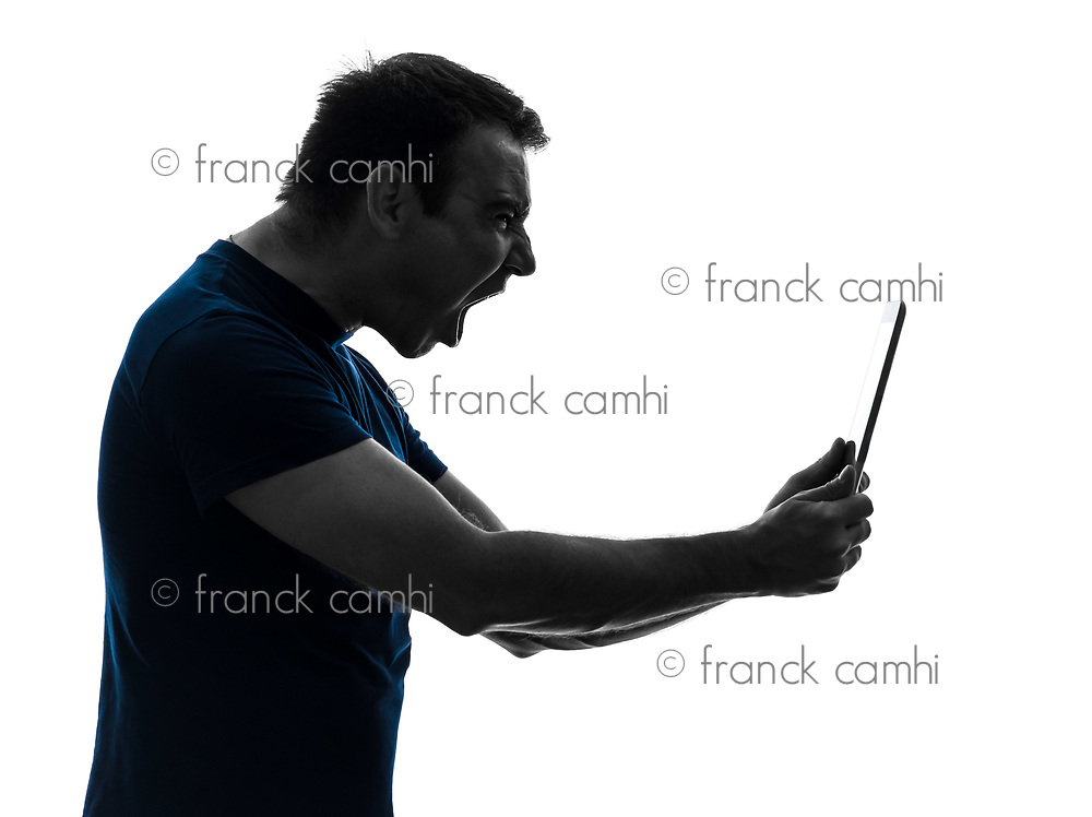 one  man holding digital tablet screaming angry furious on white background