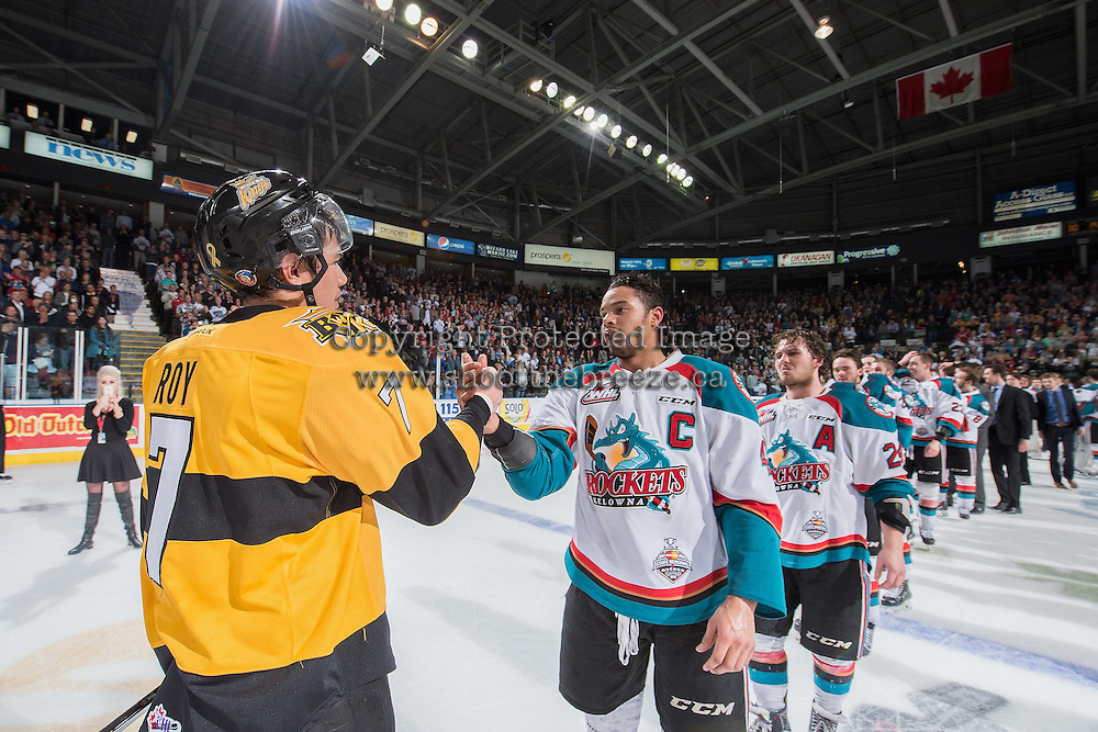 KELOWNA, CANADA - MAY 13: Eric Roy #7 of Brandon Wheat Kings shakes hands with Madison Bowey #4 of Kelowna Rockets after the Rockets won the WHL Championship on May 13, 2015 during game 4 of the WHL final series at Prospera Place in Kelowna, British Columbia, Canada.  (Photo by Marissa Baecker/Shoot the Breeze)  *** Local Caption *** Eric Roy; Madison Bowey;